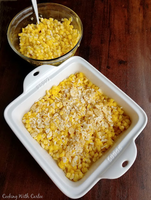 square casserole layered with corn and crackers, putting together old fashioned scalloped corn recipe
