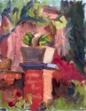 Oil painting of a brick pillar with a stone plant pot/basket on top.