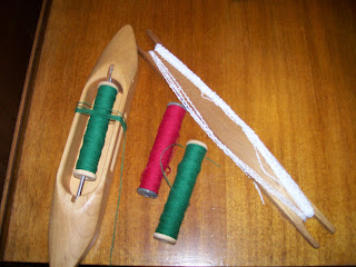 Stick and boat shuttles, extra bobbins for boat shuttle.