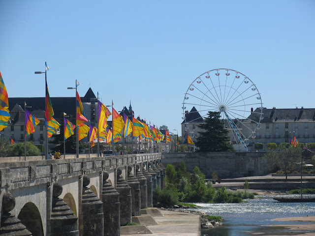 Ferris wheel at the Pont Wilson Bridge by the river Loir in Tours