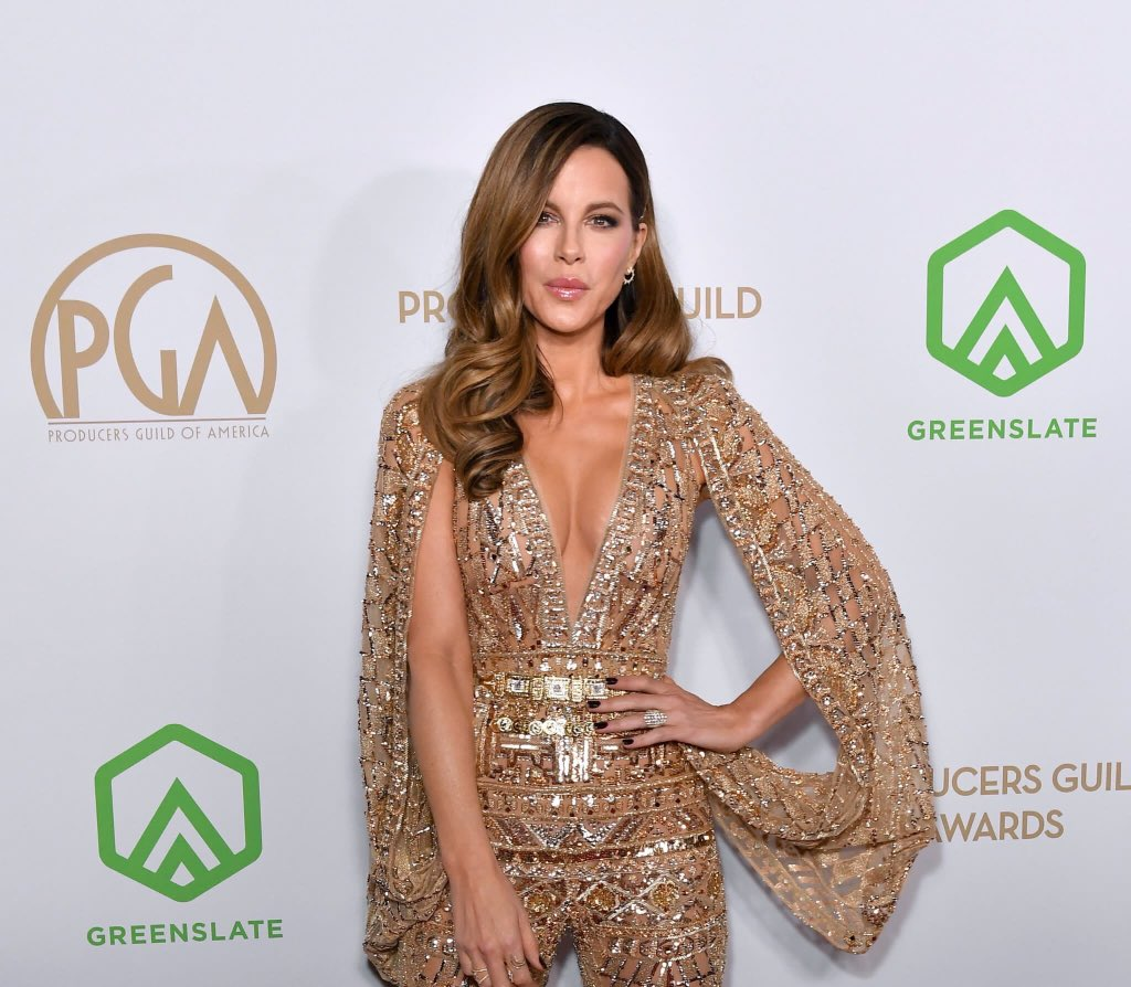 Kate Beckinsale dazzles in gold jumpsuit with plunging neckline and caped sleeves as she presents prize at 31st Annual Producers Guild Awards