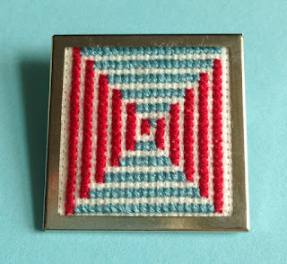 Floss & Fleece: cross-stitch op art pin