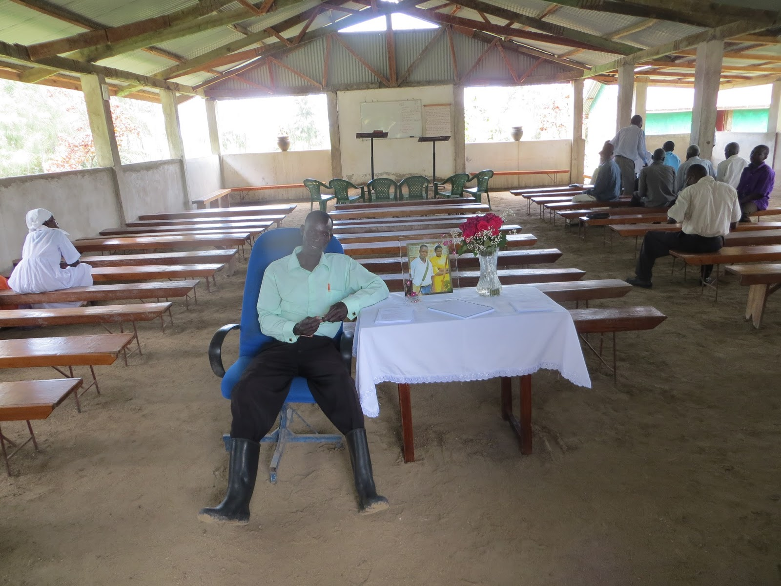 A seminar a wedding at nyakoko an hail on a rusty tin roof