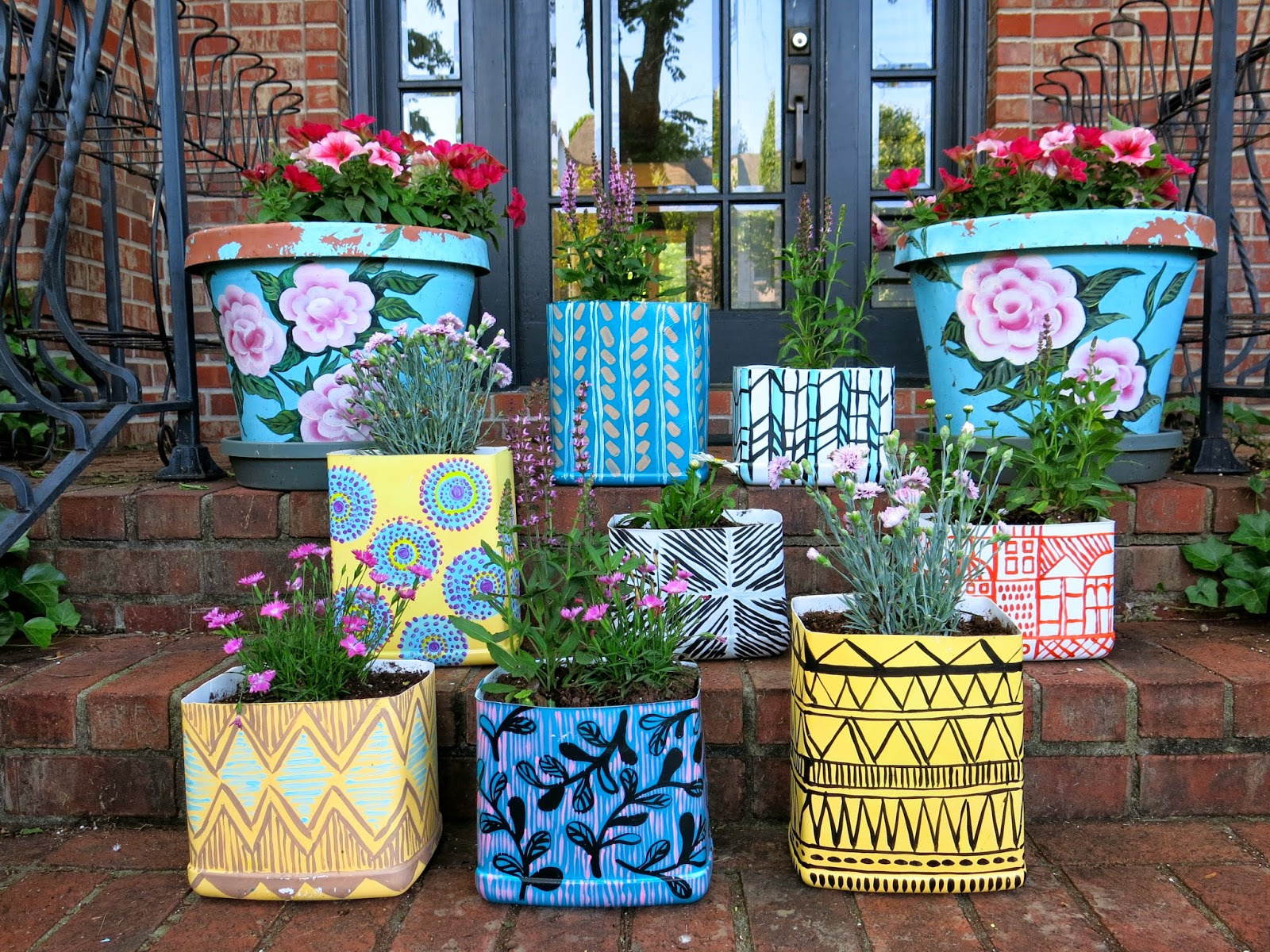 hand geraniums scalloped and concrete edging half water white pink pump antique ideas planter barrel planters painted with pansies yellow garden