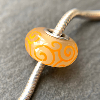 Handmade lampwork glass silver core big hole charm bead by Laura Sparling made with CiM Lemongrass