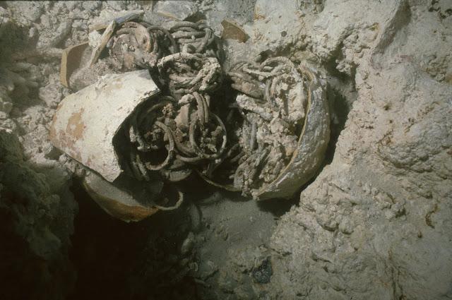 Bronze rings packed inside an earthenware jar