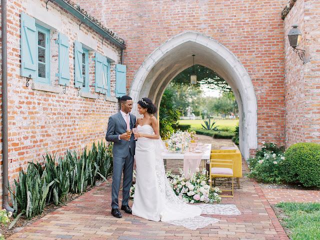 bride and groom cheers at dinner