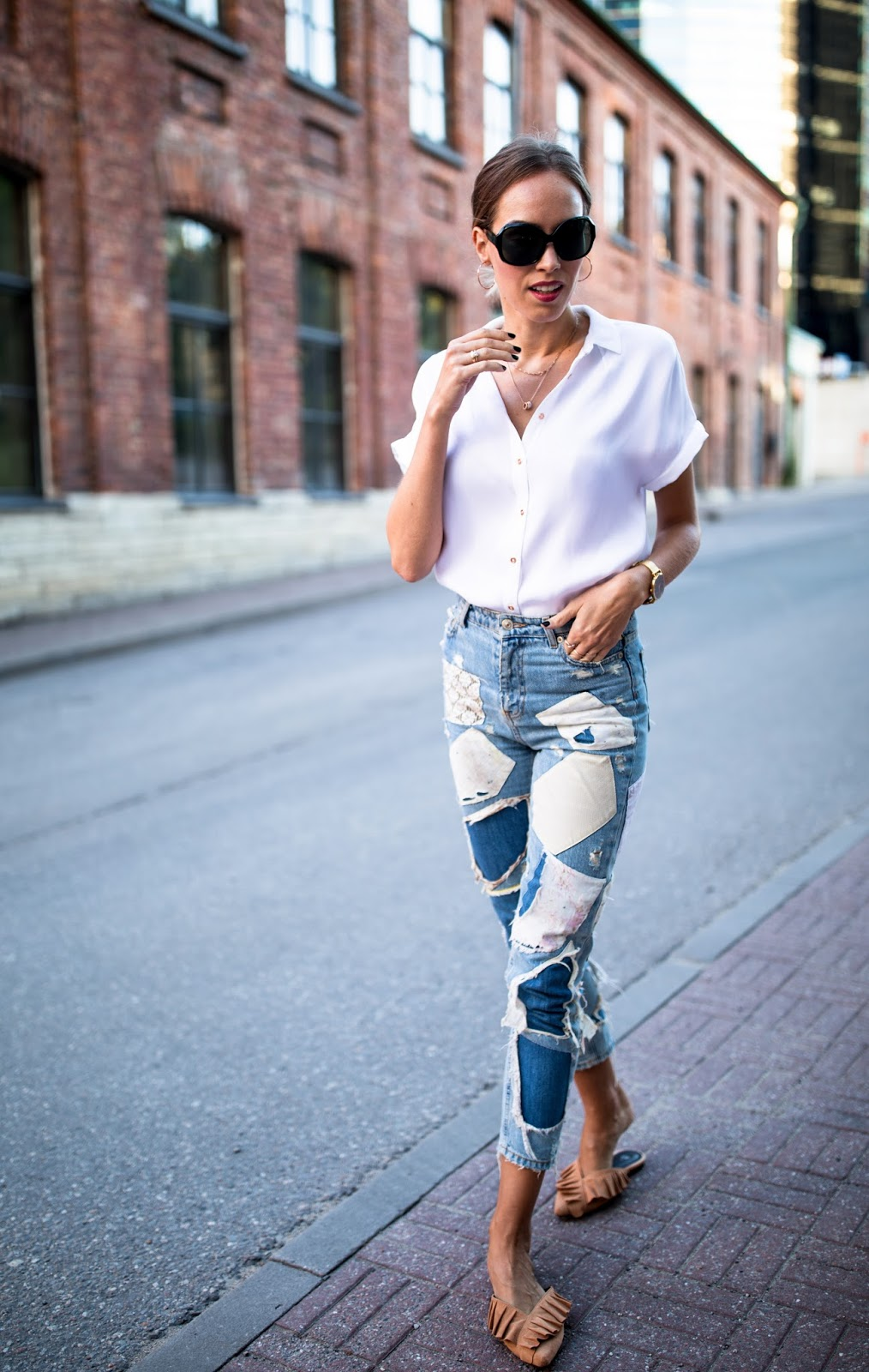 white short sleeve button down shirt patch jeans outfit