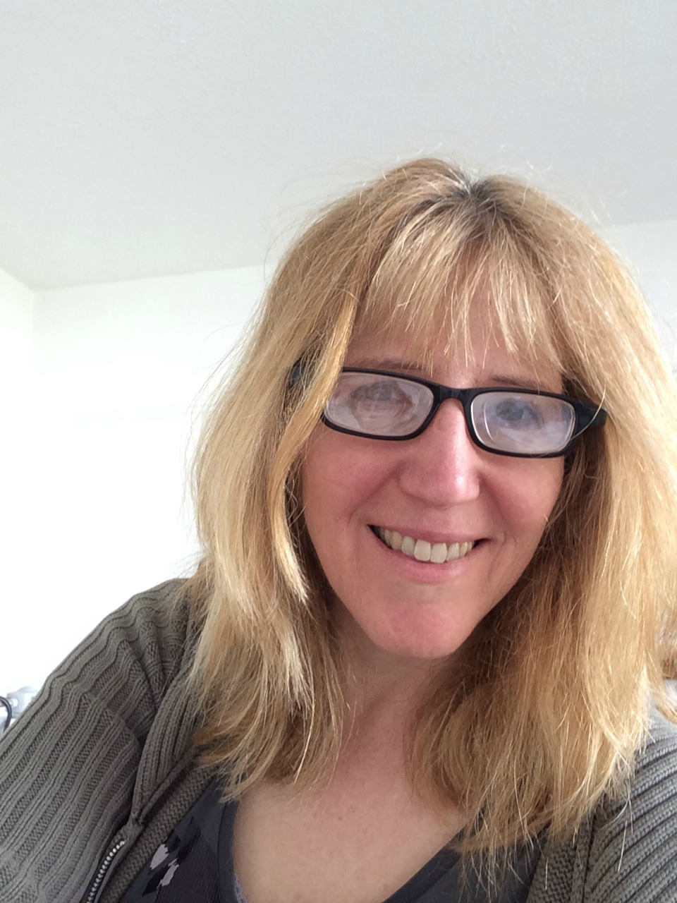 Linda Hobbis wearing Eyejusters adjustable reading glasses