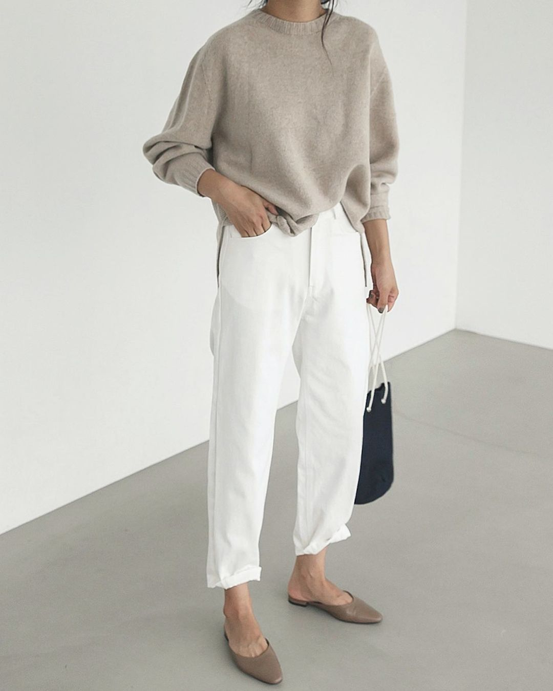 Stylish Fall Outfit Idea with Neutrals — Deathbyelocution Instagram Style with Beige Sweater, White Jeans, and Taupe Mule Flats
