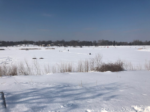 Ice fishing at Hidden Lake Forest Preserve in winter.