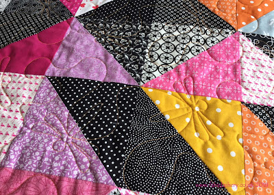 Sherry's Half Square Triangle quilt  featuring Dragon Wings quilting pattern