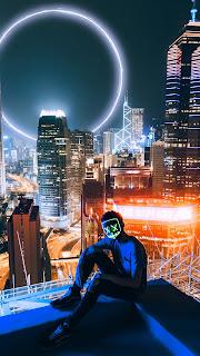 Mask Man Sitting Mobile HD Wallpaper