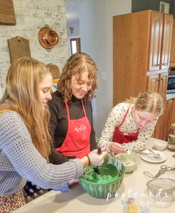 girls baking thumbprint cookies