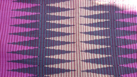 Rangrang Nusa Penida Bali is a traditional mitt woven textile amongst brilliant colors in addition to motifs BaliBeaches: Rangrang Nusa Penida Bali - Beautiful Motifs & Bright Colors of the Traditional Hand Woven Fabric of Bali