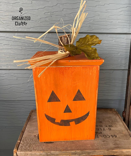 Photo of a wooden canister repurposed as a Halloween Jack-o-lantern