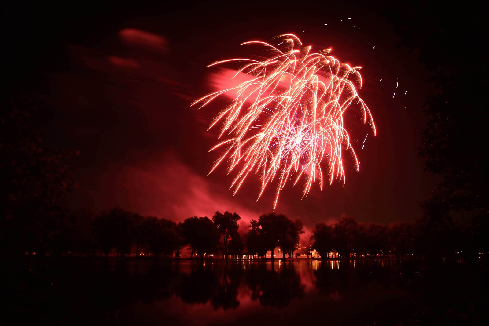 red fireworks over water