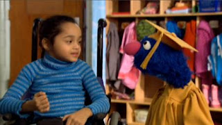 Professor Grover and a little girl are talking. Sesame Street Preschool is Cool ABCs With Elmo.