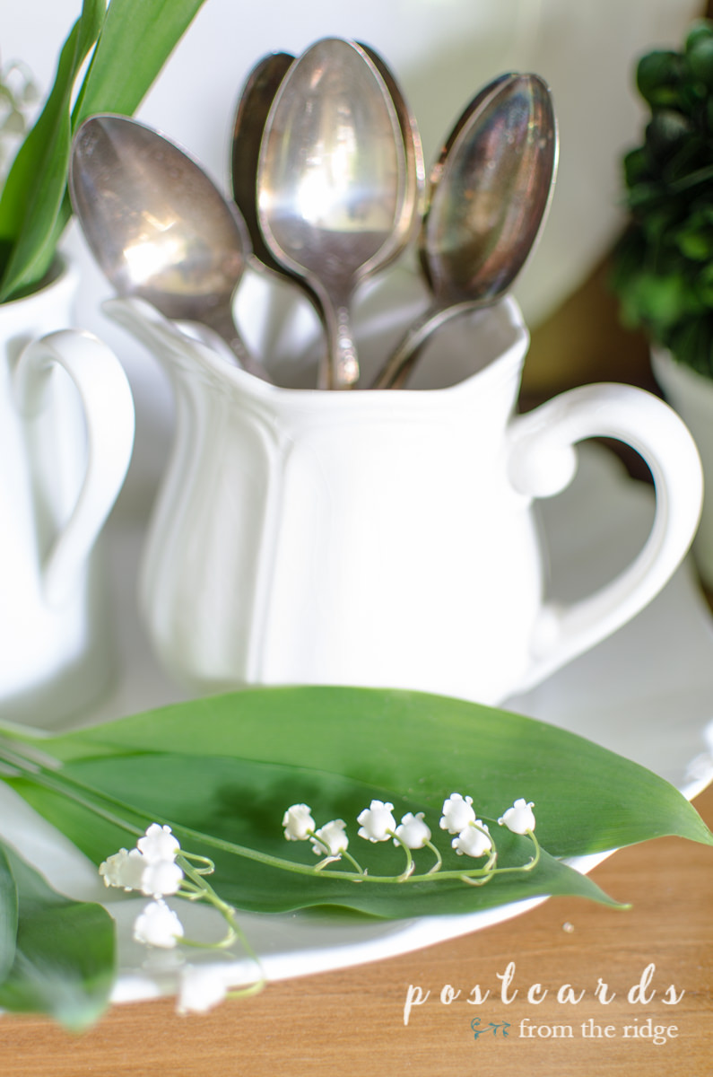 lily of the valley and vintage silver with white ironstone
