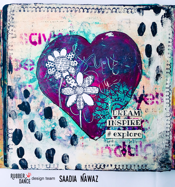 An art journal spread with acrylic paints, stencils and Rubber Dance stamps