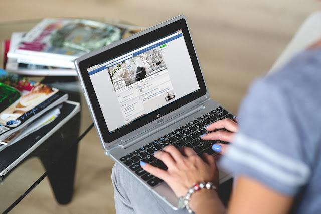 Men hands with laptop.