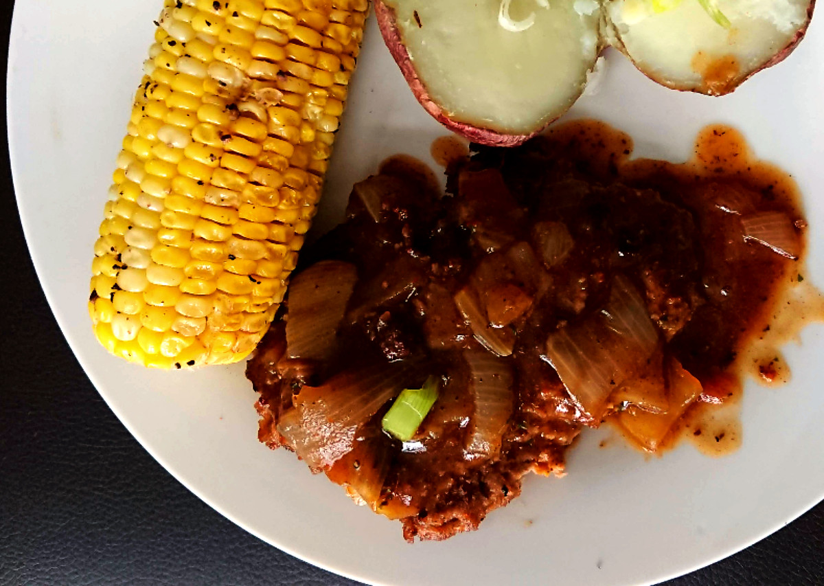 Allergy Friendly Salisbury Steak on a plate with corn and baked tomato