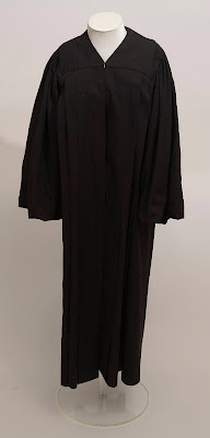 Display mannequin with black judicial robe