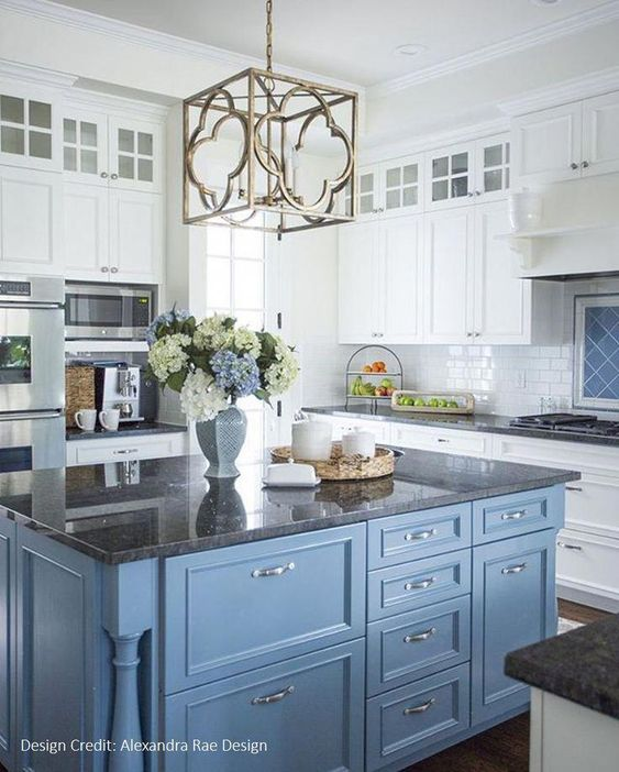 blue kitchen island with white cabinets