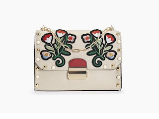 https://www.stradivarius.com/rs/woman/accessories/bags/view-all/messenger-bag-with-large-embroidered-flowers-c1020047079p300096537.html?colorId=450