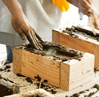 How to make mud bricks like they did in ancient time:   This picture shows the wood frame for a mud bricks.
