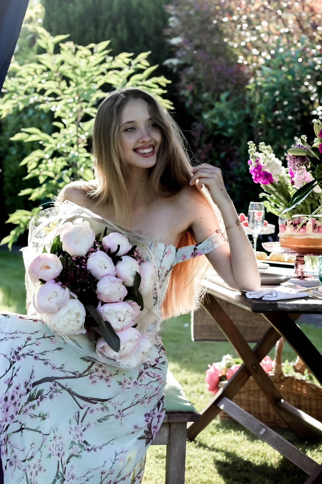 Fashion Blogger Holding Bouquet of Flowers Peonies