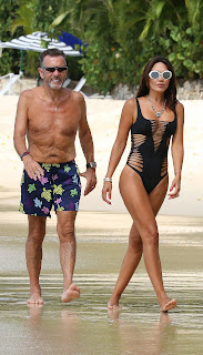Nigora-Bannatyne-in-an-one-piece-black-swimsuit-at-the-beach-in-Barbados.-77idk71kk6.jpg