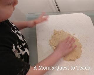 little kid baking cookies