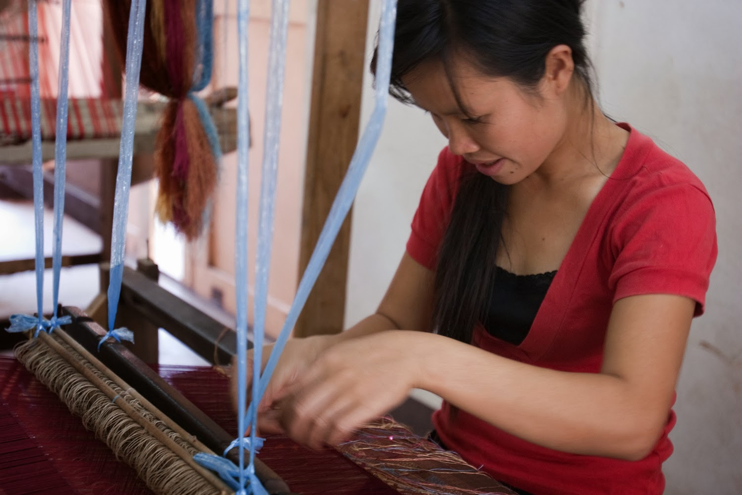 Young Lao weaver at the Houey Hong Vocational Training Centre for Women in Laos