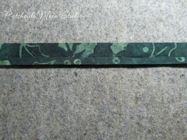 fabric strip showing how fabric stems for flowers are made