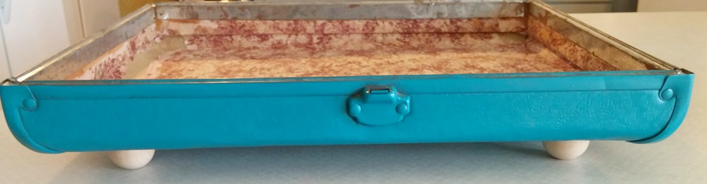 making a tray from an old suitcase lid