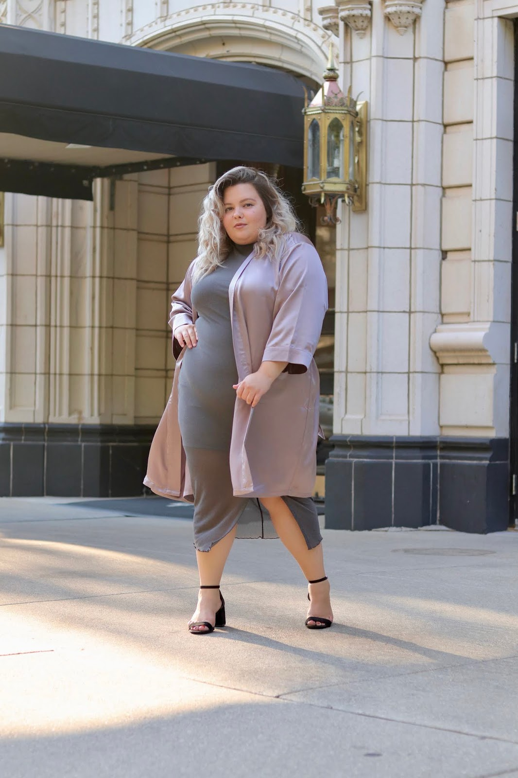Chicago Plus Size Petite Fashion Blogger, influencer, YouTuber, and model Natalie Craig, of Natalie in the City, reviews Soncy's satin robe kimono duster in lavender, and the brand's see through mesh dress with a slit.