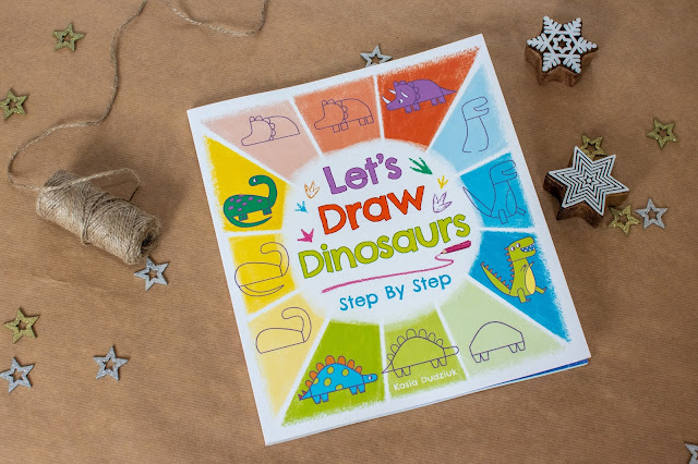 A book with cartoon dinosaurs on the front called Let's draw dinosaurs Step By Step