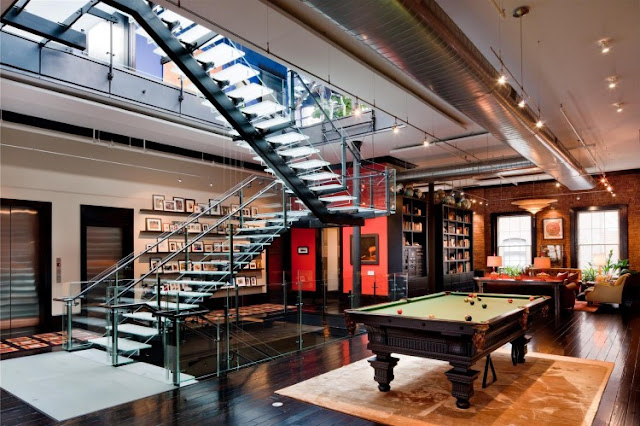 Photo of pool table on the second floor of Tribeca triplex along with glass staircase