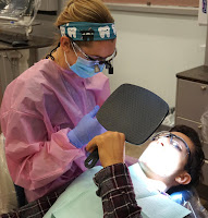 photo of a dental hygiene student working with a teen