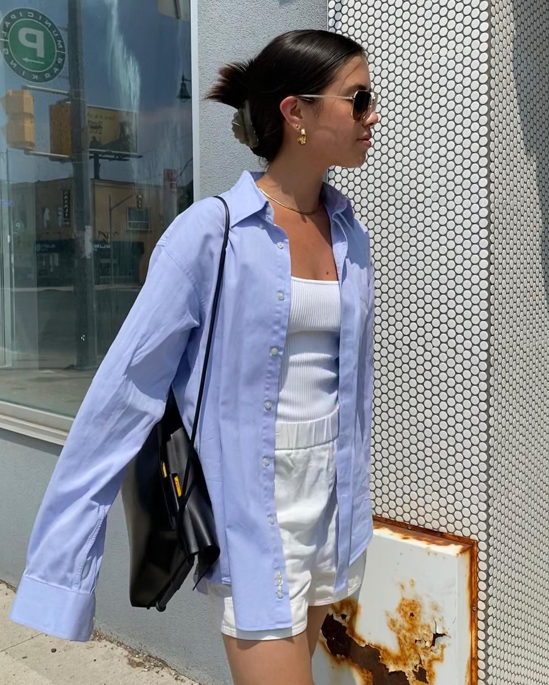 This Casual-Cool Outfit Combo Is Trending on Social Media —Sasha Mei in a blue button-down shirt, white ribbed tank top, sporty white boxer shorts