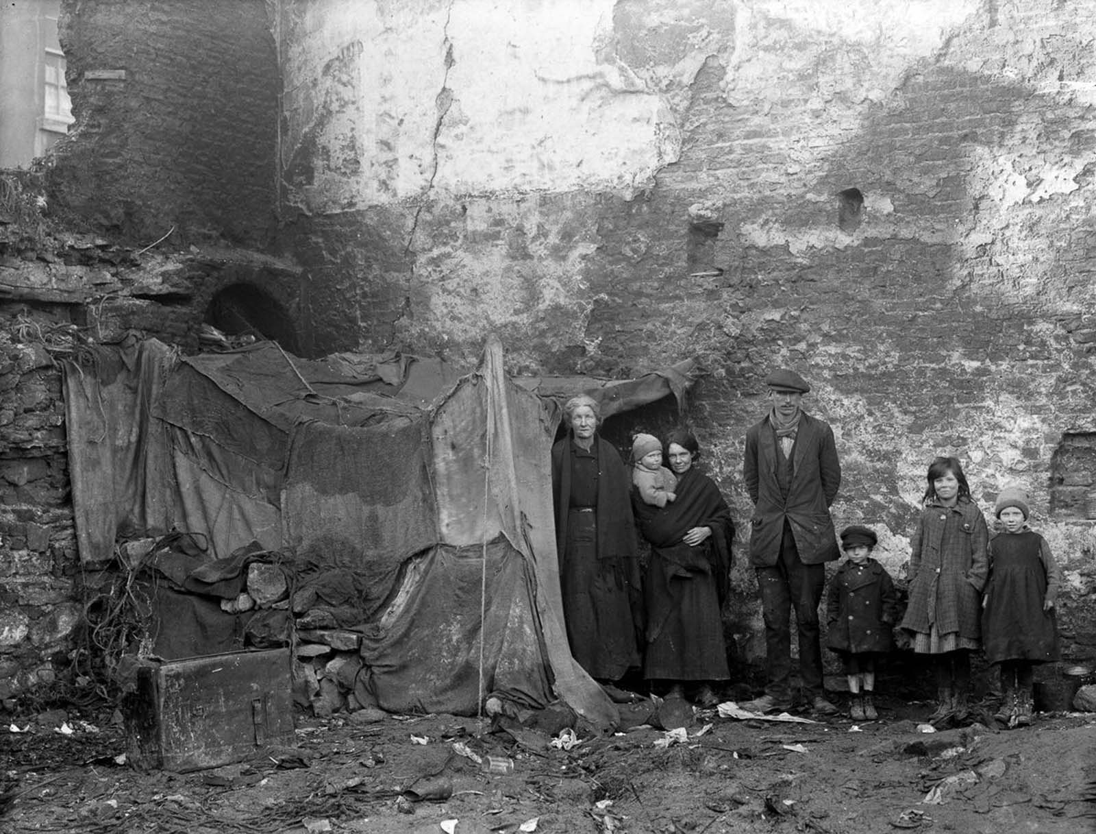 Three generations of a family pose beside their home at Alexander Street, Waterford. 1924.