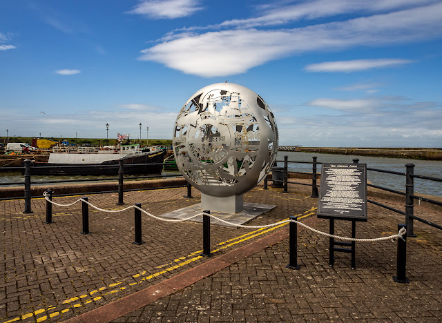 Photo of a sculpture on the harbourside in Maryport