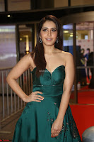 Raashi Khanna in Dark Green Sleeveless Strapless Deep neck Gown at 64th Jio Filmfare Awards South ~  Exclusive 087.JPG