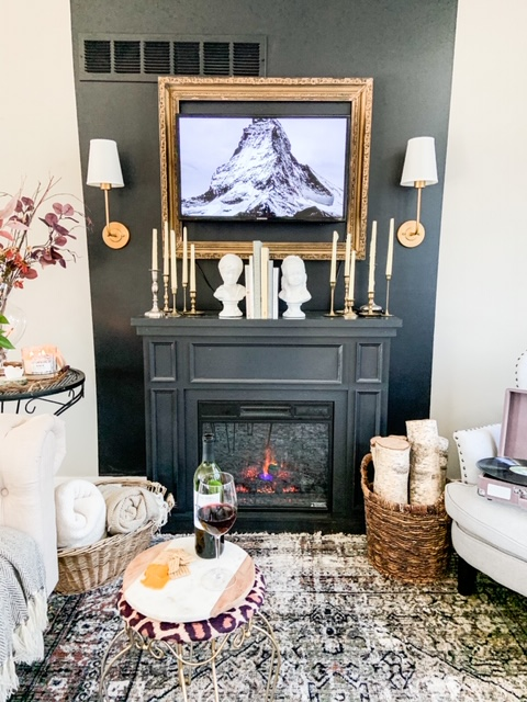black fireplace with gold accessories