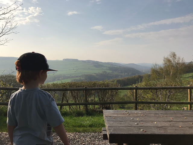 Imaging showing a little boy looking out into the peak district hills