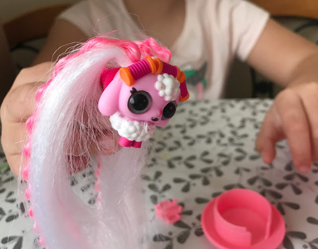 long haired animal pet from the pop pop hair surprise