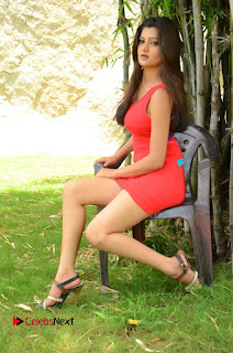 Actress Poojitha  Pictures in Red Short Dress at Bullet Movie Opening  0136.JPG