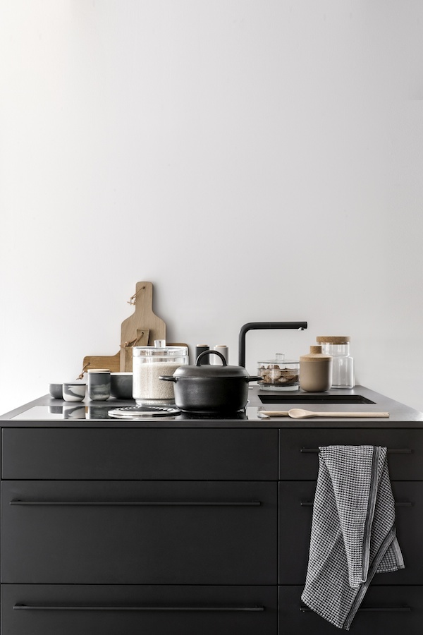 A Beautiful All Black Kitchen And And Dining Room With