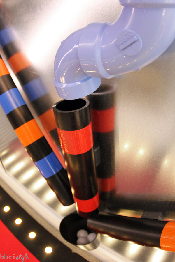 PVC pipes and duct tape create the ping pong ball run on a magnetic wall in the basement playroom.